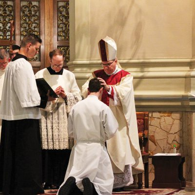 The Bishop with His Deacons