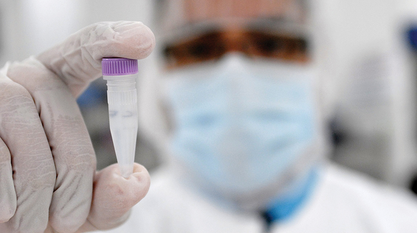 ANALYST HOLDS CRYOVIAL AT NEW STEM-CELL RESEARCH FACILITY IN FLORIDA